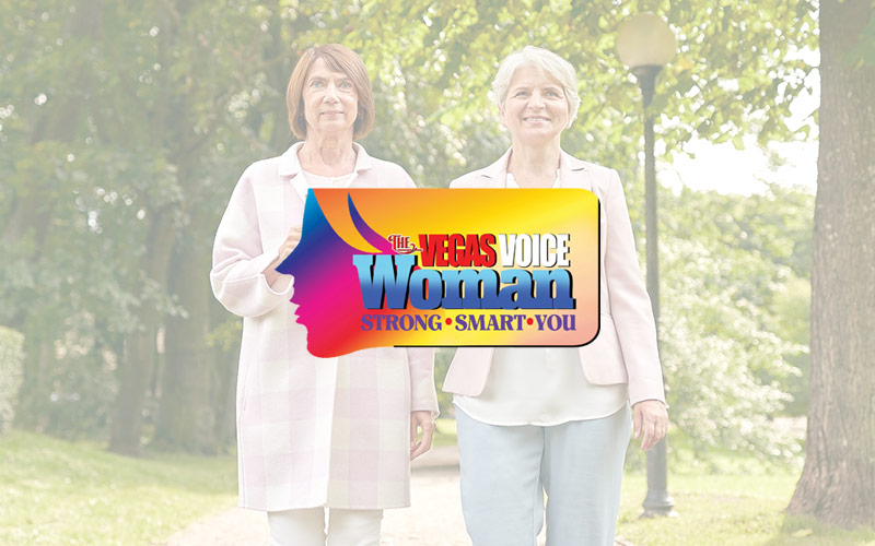 Two-smiling-older-women-with-The-Vegas-Voice-Woman-Logo-in-the-center